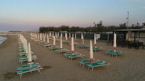 Private beach, sun-loungers, beach umbrellas, beach volleyball