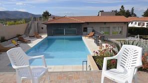 Indoor pool, seasonal outdoor pool, open noon to 3:00 AM, sun loungers
