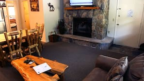 42-inch TV with cable channels, fireplace