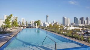 Outdoor pool, open 7:00 AM to 10:00 PM, pool loungers