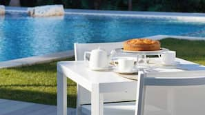 Outdoor pool, open 9:00 AM to 7:30 PM, free pool cabanas, pool loungers