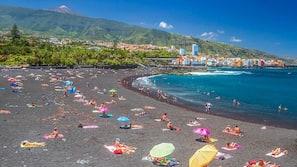 On the beach, black sand, sun loungers, 10 beach bars