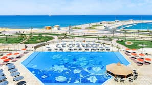 3 outdoor pools, open 8:00 AM to 5:00 PM, free cabanas, pool umbrellas