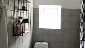 Shower, designer toiletries, hair dryer, towels