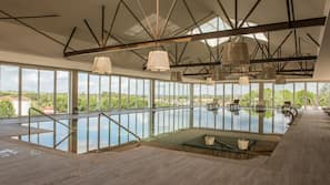 Indoor pool, 2 outdoor pools, open 9:00 AM to 8:00 PM, pool umbrellas
