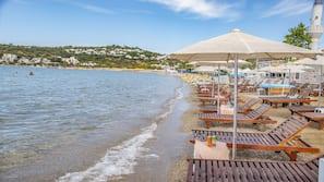 On the beach, beach shuttle, sun-loungers, beach umbrellas