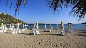 Private beach, sun loungers, beach umbrellas