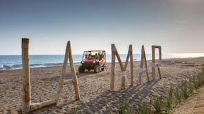 Private beach, black sand, free beach cabanas, sun loungers