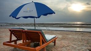 Private beach, beach umbrellas
