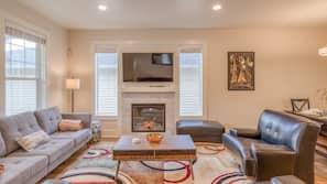 Flat-screen TV, fireplace, DVD player, toys