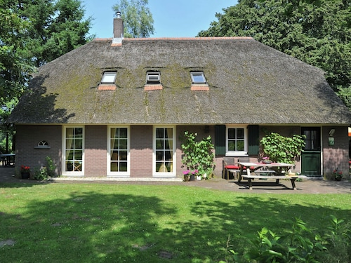 An Authentic Veluwe Farm House With Thatched Roof in the Countryside