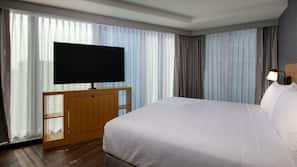 Desk, laptop workspace, blackout curtains, bed sheets