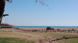 On the beach, beach umbrellas, beach yoga, beach volleyball