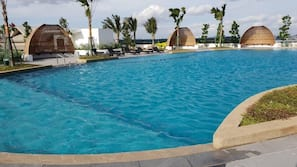 Outdoor pool, open 7:00 AM to 11:00 PM, free pool cabanas