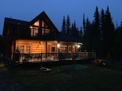 Custom Built log Home Surrounded by Lakes
