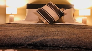 Premium bedding, down duvets, pillow-top beds, individually decorated