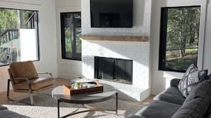 TV, fireplace, table tennis table, books