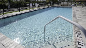 Outdoor pool, open 7:00 AM to 10:00 PM, sun loungers