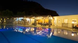 Seasonal outdoor pool, open 9:00 AM to 8:00 PM, pool umbrellas