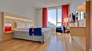 Biancheria da letto di alta qualità, cassaforte in camera, una scrivania