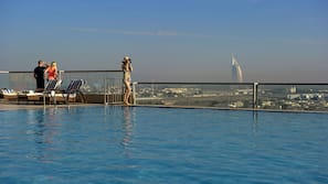 Outdoor pool, open 8:00 AM to 10:30 PM, pool loungers