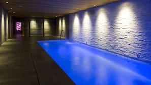 Indoor pool, a waterfall pool, pool loungers