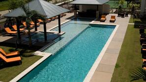 Outdoor pool, open 7 AM to 10 PM, pool loungers