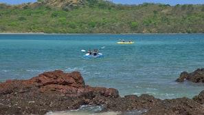 On the beach, white sand, beach towels, kayaking