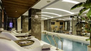 Indoor pool, open 11 AM to 9 PM, pool loungers