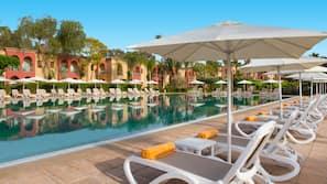 Outdoor pool, a natural pool, pool umbrellas