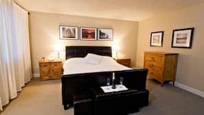 Premium bedding, down comforters, blackout drapes, iron/ironing board