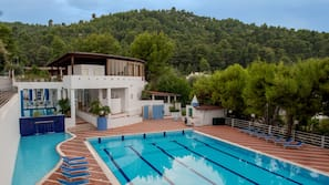 2 outdoor pools, a lap pool, open 10 AM to 7:30 PM, pool loungers