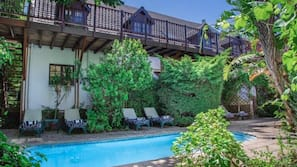Seasonal outdoor pool, open 7:30 AM to 6:30 PM, pool umbrellas