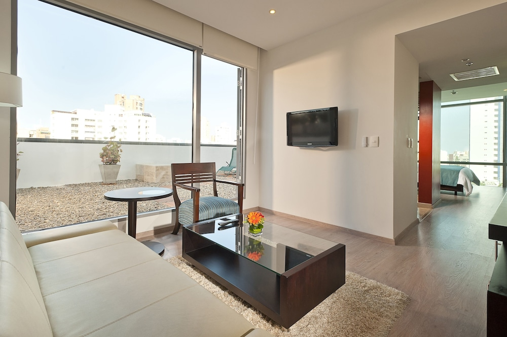 Living Area, NH Collection Barranquilla Smartsuites Royal