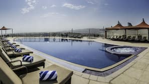 Outdoor pool, open 7 AM to 9:00 PM, pool umbrellas