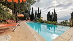 Seasonal outdoor pool, open 10:00 AM to 9:00 PM, pool umbrellas