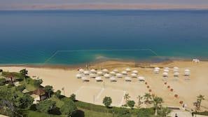 Private beach, beach umbrellas, beach towels, beach volleyball