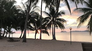 On the beach, sun loungers, beach towels, kayaking