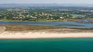 Beach nearby, white sand, free beach shuttle, beach cabanas