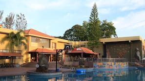 Outdoor pool, open 7 AM to 6:30 PM, pool umbrellas, pool loungers