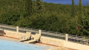 Seasonal outdoor pool, open 8:30 AM to 7 PM, pool umbrellas