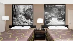 Desk, blackout drapes, free cribs/infant beds, rollaway beds