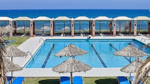 Seasonal outdoor pool, open 7:00 AM to 8:00 PM, pool umbrellas