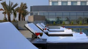 Outdoor pool, open 7:00 AM to 9:00 PM, pool umbrellas