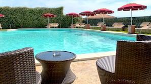 Outdoor pool, open 9:30 AM to 7:30 PM, pool umbrellas, pool loungers