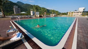 Outdoor pool, open 7 AM to 11 PM, pool loungers