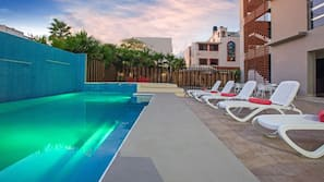 Outdoor pool, open 8:00 AM to 10:30 PM, pool umbrellas