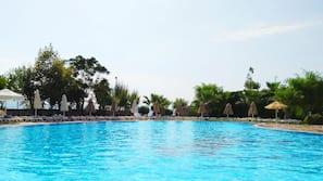 Indoor pool, 3 outdoor pools, open 7:00 AM to 8:00 PM, pool umbrellas