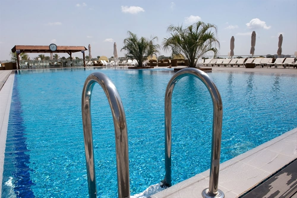 Outdoor Pool, Ramada Hotel & Suites by Wyndham Netanya
