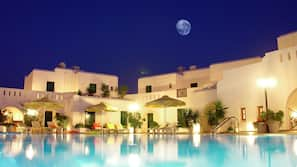 Seasonal outdoor pool, open 11 AM to 8 PM, pool umbrellas, sun loungers
